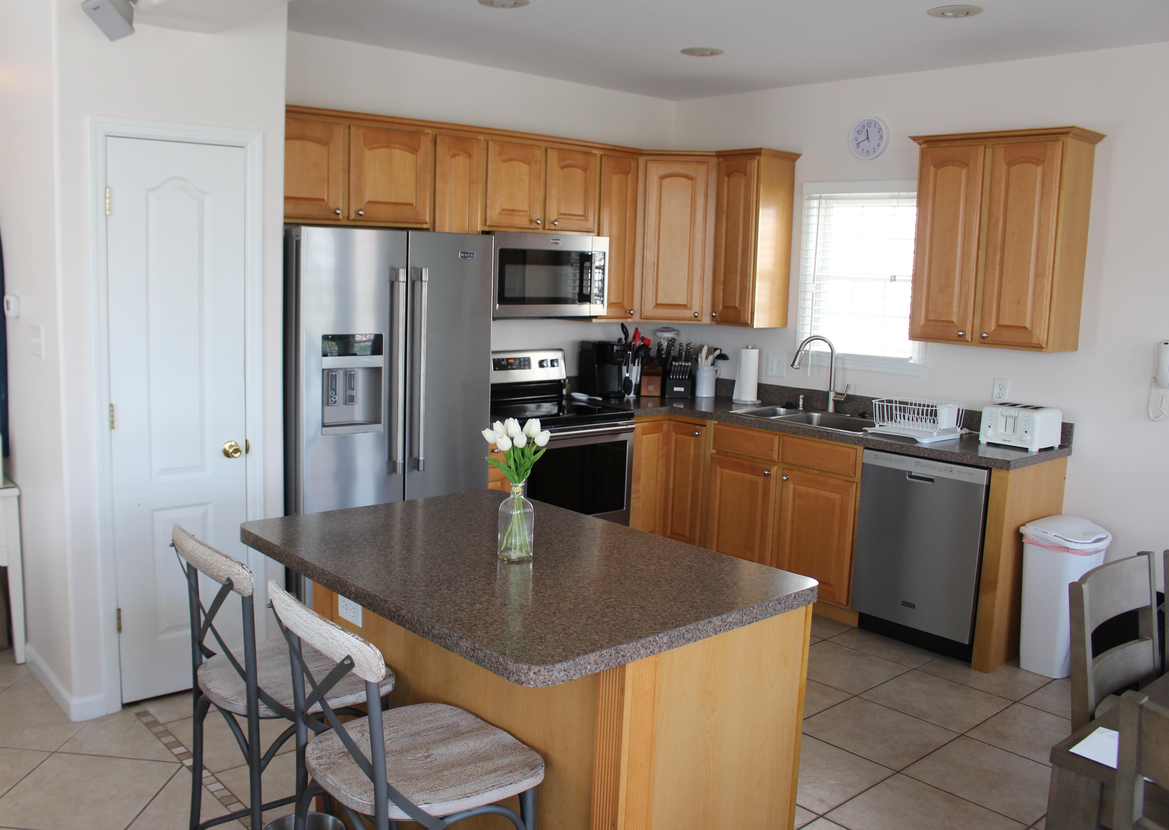 Kitchen with island bar stools