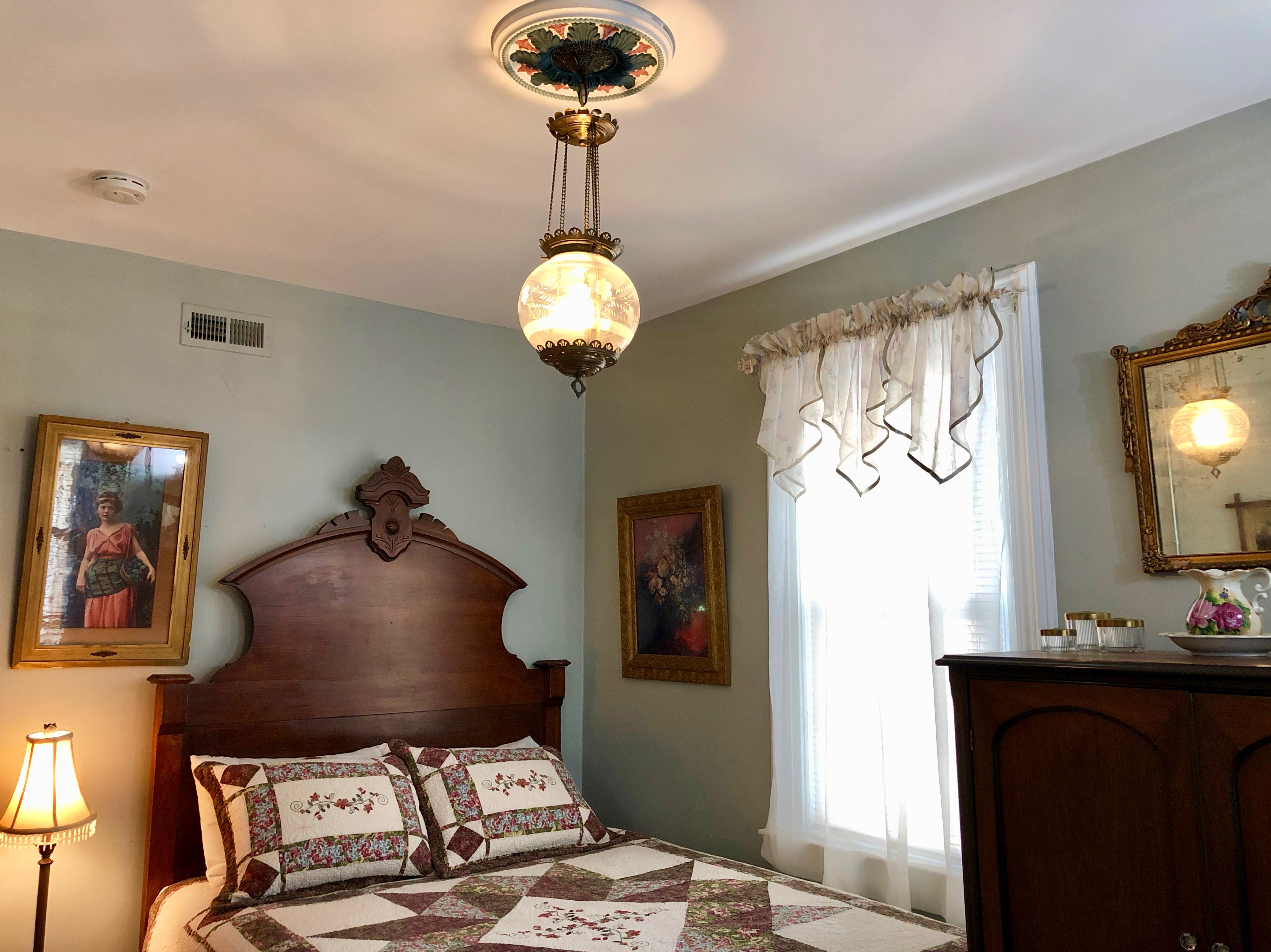 Serenity Bedroom with queen bed and Victorian light
