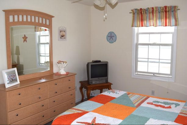Another View of the Bright and Cheery Master Bedroom with Queen Bed