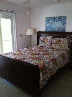 Queen bedroom which opens to first floor deck