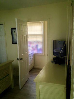 UPPER CONDO Master Bedroom - 1/2 Bathroom