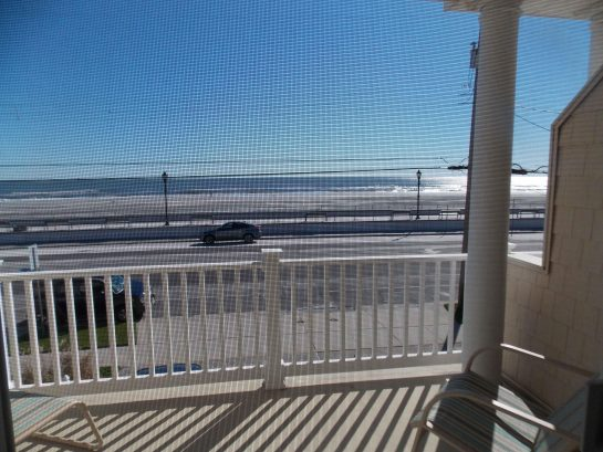 Ocean view sitting on master  bedroom bed!