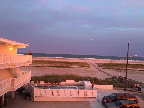 Beautiful beach at sunset from balcony