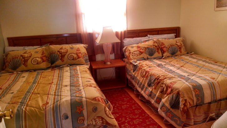 private bedroom w/ two double beds