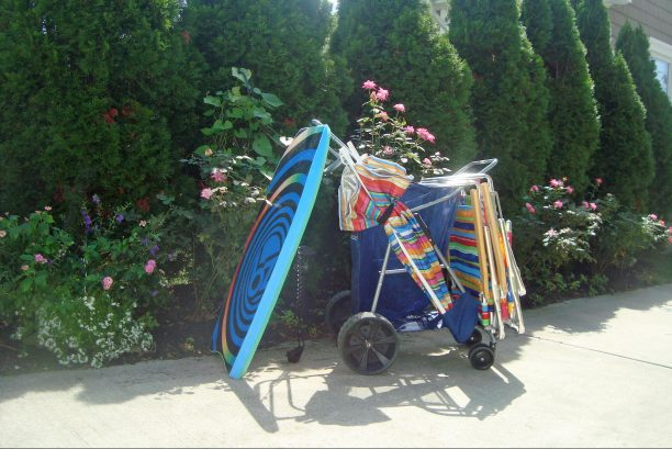 Includes beach tags, beach chairs, cart, umbrella, and boogie boards