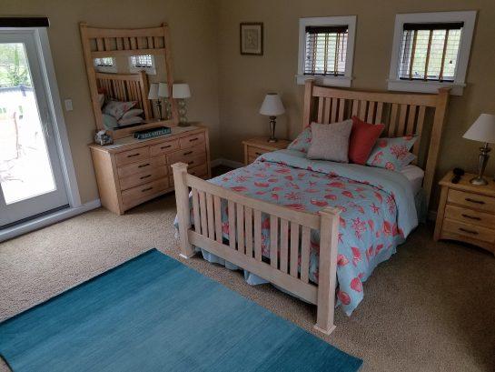 Upsatirs Queen Bedroom with Balcony Overlooking Pool