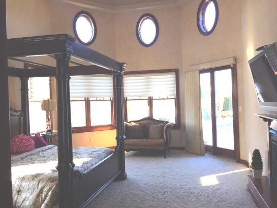 Master Bedroom With Slider To Pool