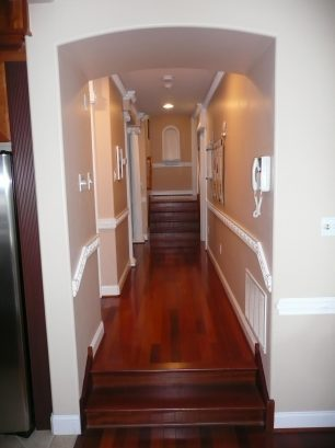 Hallway with view of steps to bedrooms (back) and living room (front).