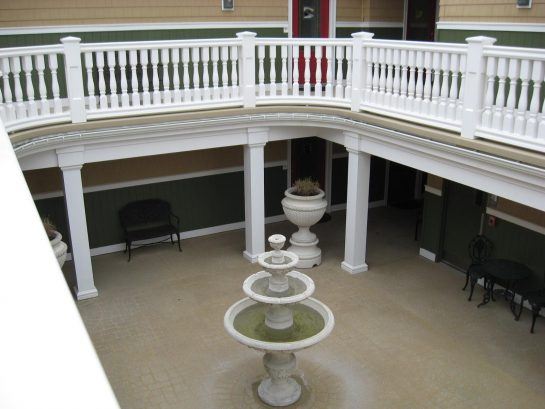 Overlooking common courtyard with fountain and seating