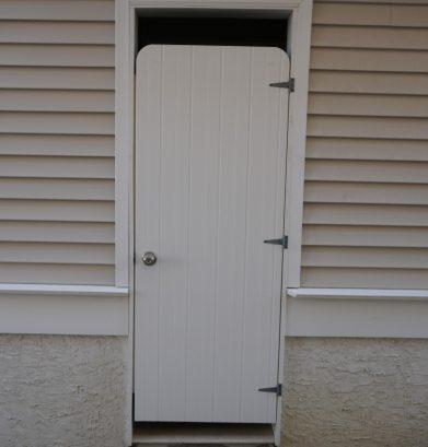 Outdoor shower (door inside that provides access to garage)