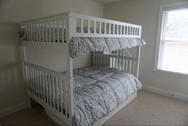 Bedroom #3 - bunk bed with two full beds and 1 twin trundle