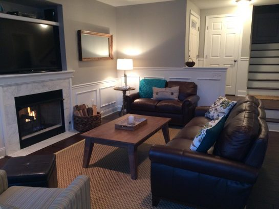 "1st Floor Living Room - Leather Couch & Love Seat, fireplace and 60"" TV"