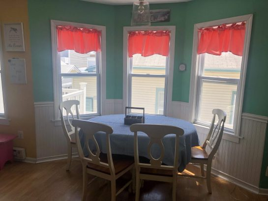 Seating for six at the table, four on stools, plus card table with four folding chairs in kitchen closet