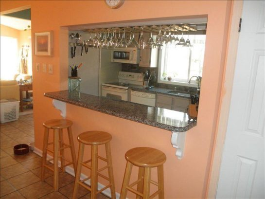 Bar area with wooden stools. New granite bar top.