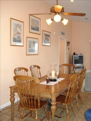 Dining Area with Open Floor Plan and High Ceilings. Table seats up to 8.
