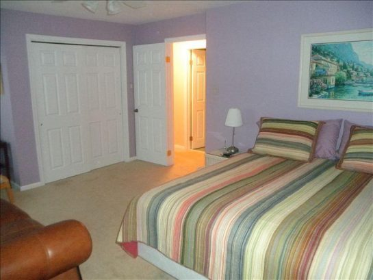 Master Bedroom with king size bed and spacious closet. 4 windows facing bay.