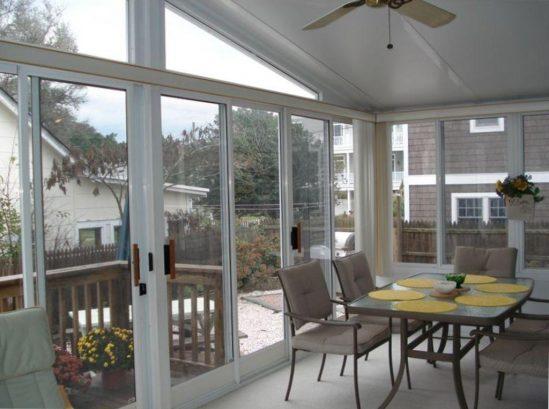 Sun Room with Backyard and Bay Views.