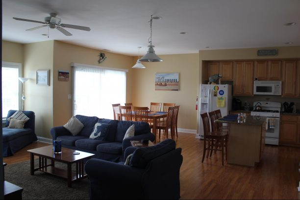 Open concept living area w/8 top table plus 3 counter seats.