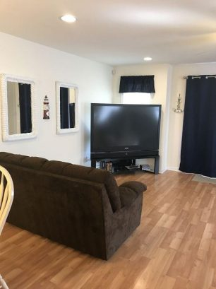 """Living Room with 67"""" Big Screen TV - DVD - 100 Channel Cable"""