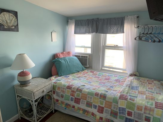Trundle bedroom with ocean views and TV