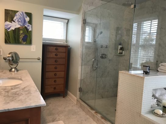 Master bath has a walk-in shower with double shower head.