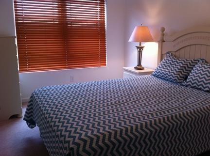 Third floor guest bedroom with queen size bed.