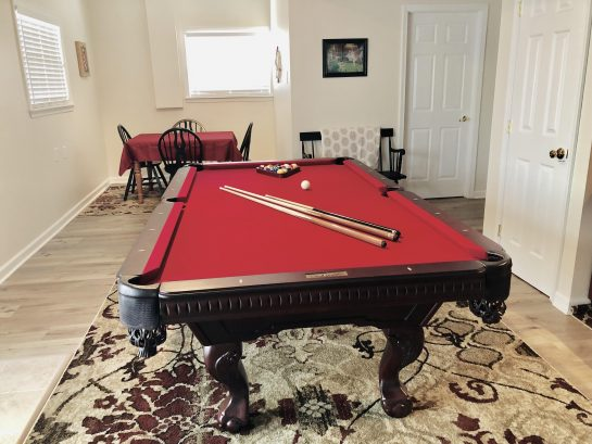 1st Floor - 8' slate pool table; family games, game table, books, dvds