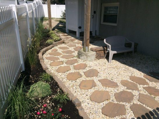 Lovely paved back entrance with fenced yard and vinyl outside h/c shower.