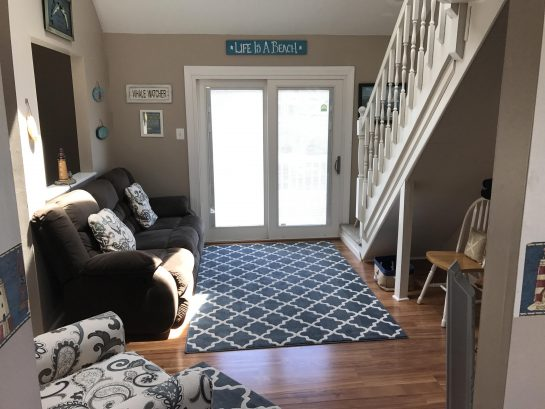 Living Room, Doors to front Deck and stairs to loft