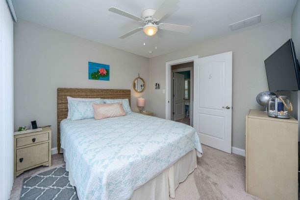 Bedroom # 5 - Queen bed, TV, slider to Juliet balcony overlooking 9th street