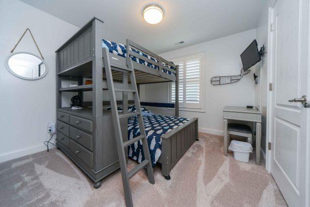 Bedroom # 3 - full over full bunk beds, TV, vanity desk