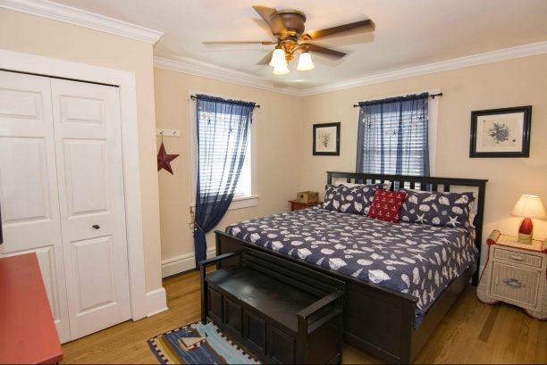 Spacious main floor bedroom with king bed