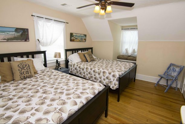 Spacious upstairs bedroom with 2 queen sized beds