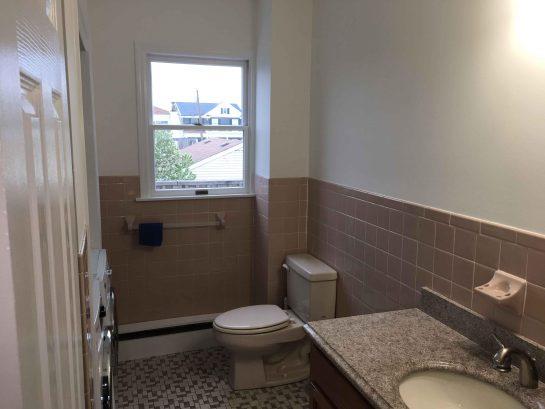 Unit 2 Main Bath - Full Bath w/ washer/dryer