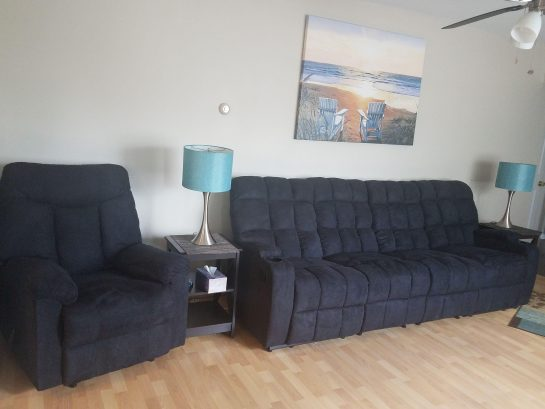 living room with reclining seats for 5