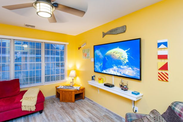 """❤️The living room is just Incredible! It's a Great Place for you to gather with friends and family! Enjoy great views and the fresh sea air from the Large Outside Deck! There is also a HUGE 70"""" HDTV with Free HBO, Sports Channels, and ov"""