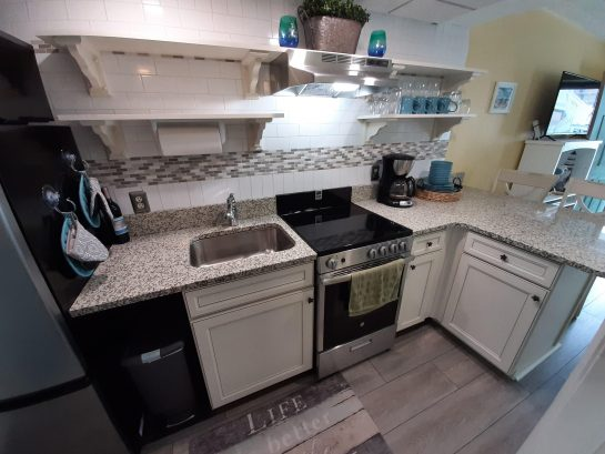 Granite counter tops and new stainless appliances.