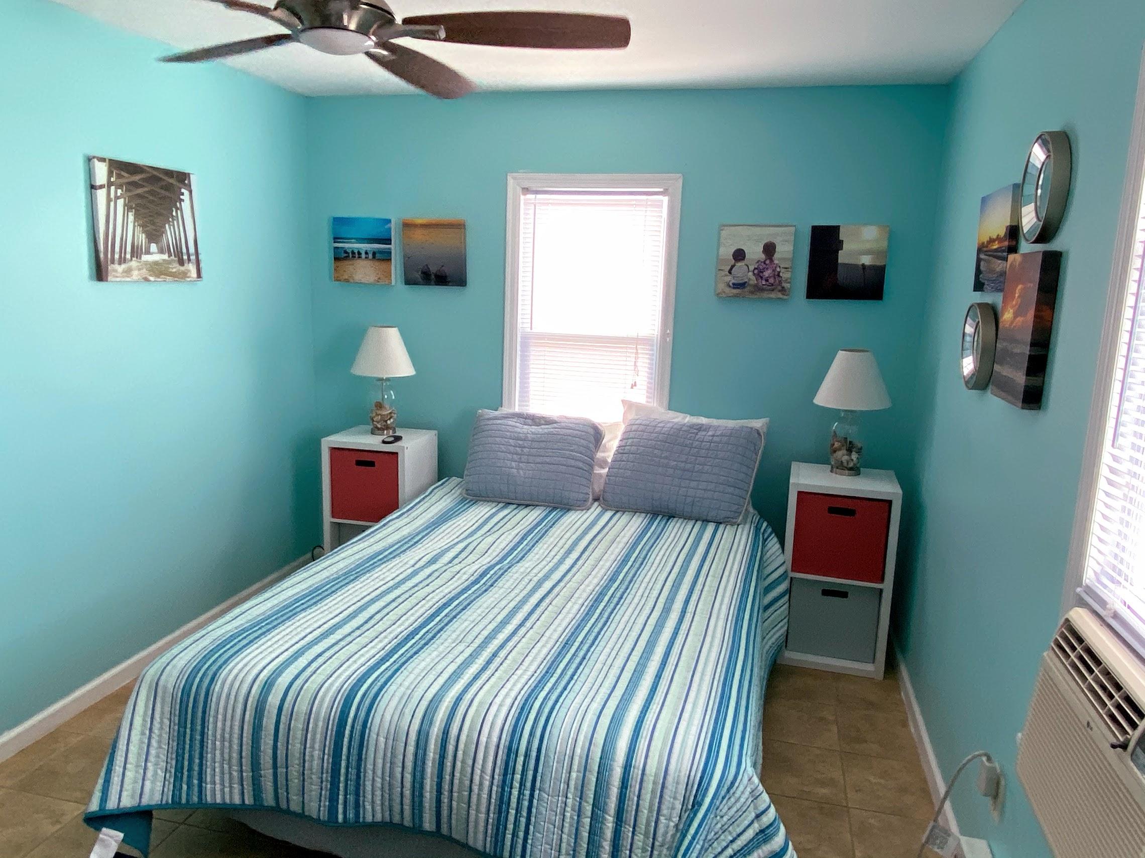 BR 2 - queen bed, ceiling fan, window AC