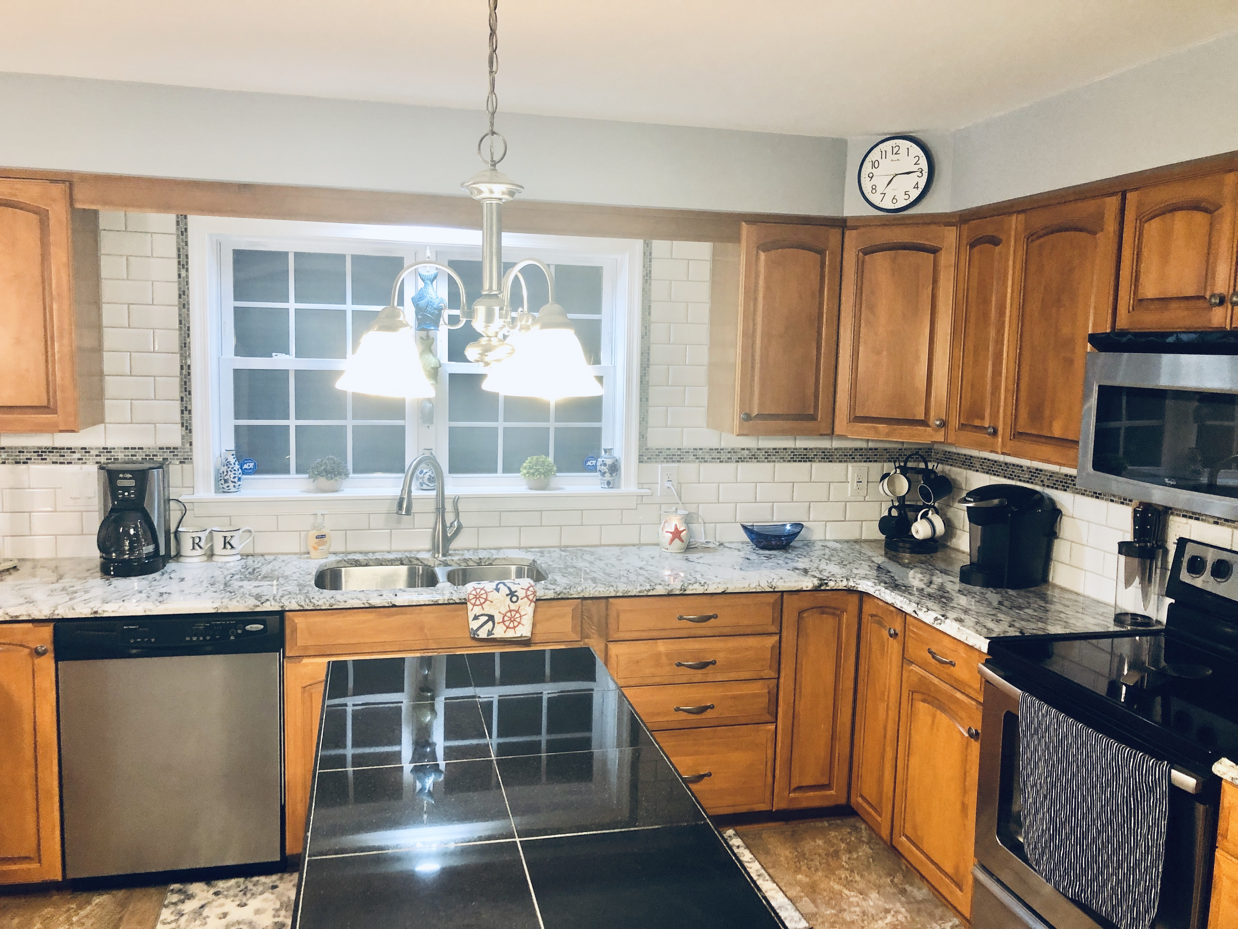 Center island that adds more worktop space to an already massive kitchen.