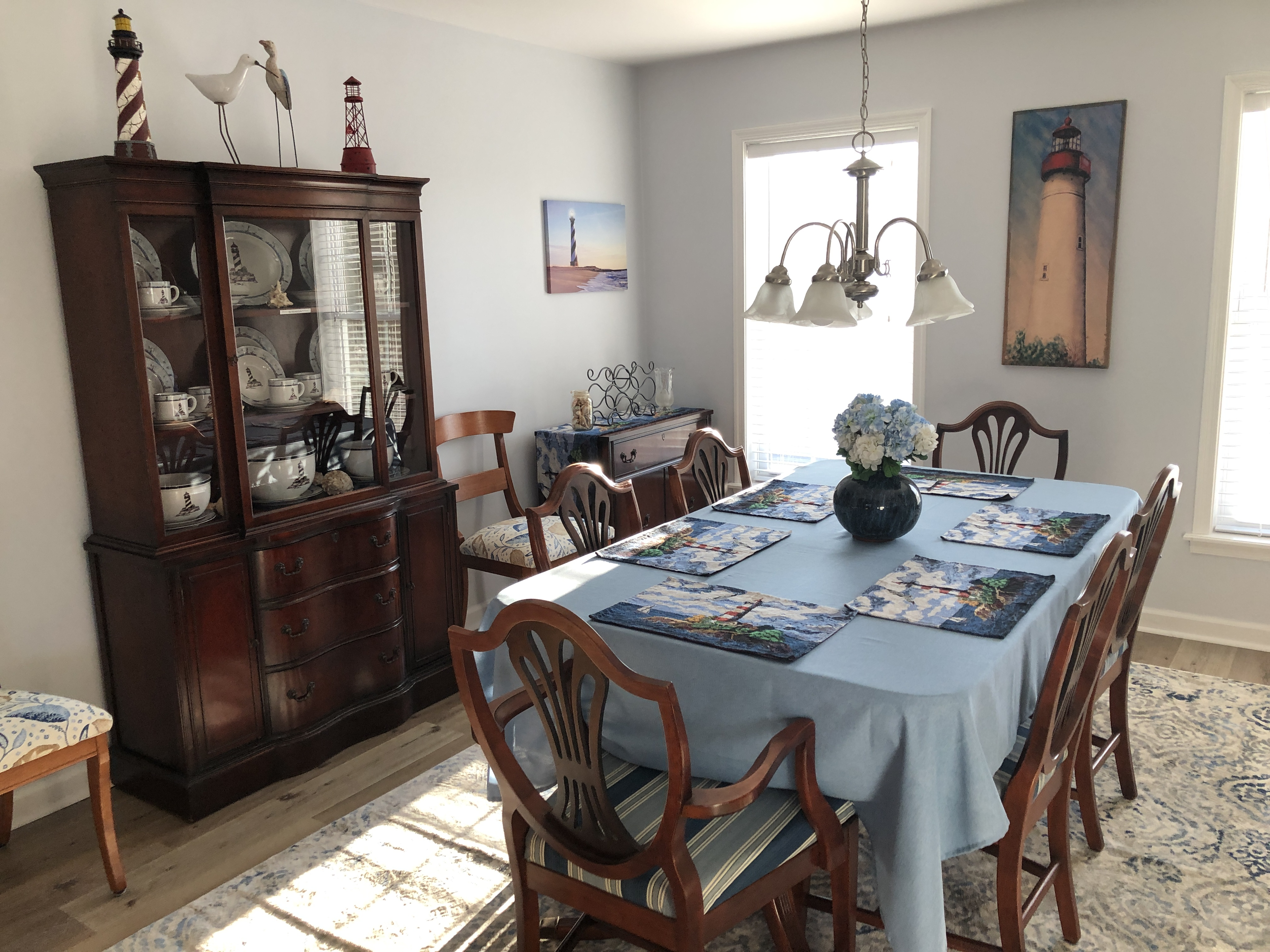 Nautical themed formal dining room that seats up to 8 people.