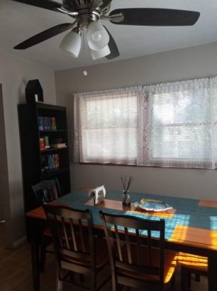 dining room with ceiling fan; window a/c