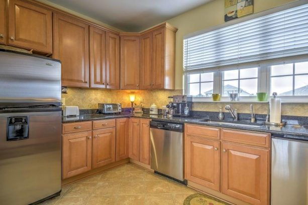 Complete with stainless steel appliances and beautiful granite counter tops, the kitchen makes for a pleasurable cooking experience.