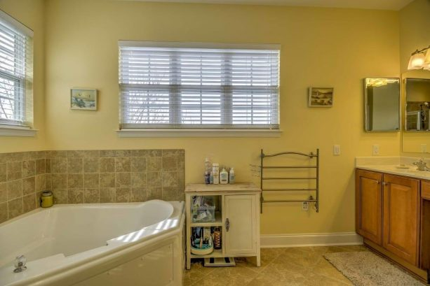 Rinse and soak away the daily activities in the master bathroom, complete with a jacuzzi tub and walk in shower.