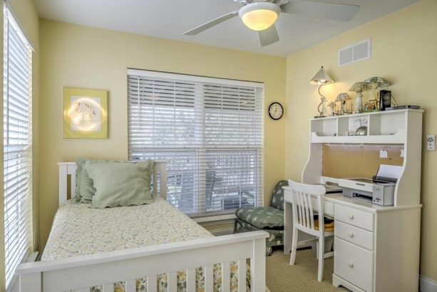 Natural light illuminates the interior of this cozy bedroom.