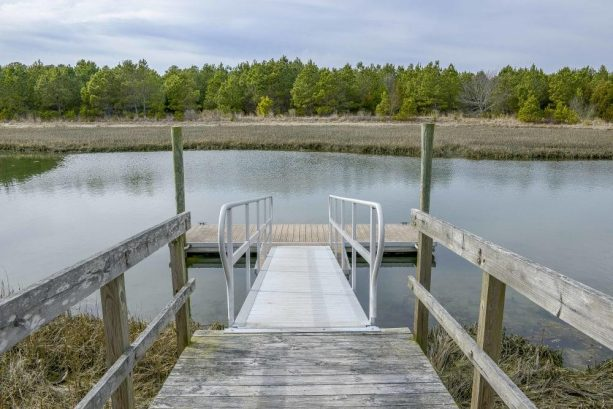 Use the property's sea kayak to explore the water surrounding the community dock.